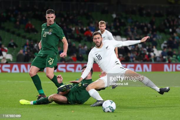 Elliot Collier of New Zealand is challenged by Kevin Long of Republic of Ireland during the International Friendly match between Ireland and New...