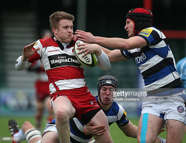 Elliot Creed of Gloucester looks to hand off Bath's Ed Coulsen during the The U18 Academy Finals Day match between Bath and Gloucester at Allianz...