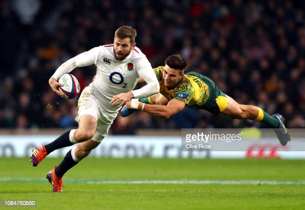 Elliot Daly of England avoids a tackle by Jack Maddocks of Australia during the Quilter International match between England and Australia at...
