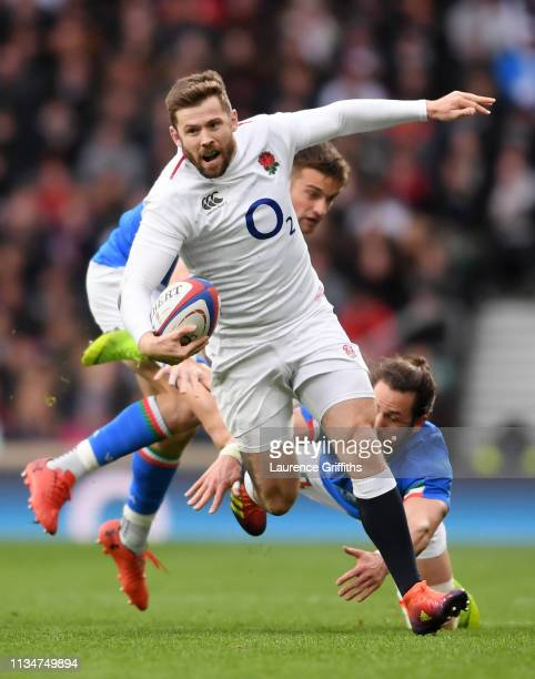 Elliot Daly of England breaks past Michele Campagnaro and Edoardo Padovani of Italy during the Guinness Six Nations match between England and Italy...