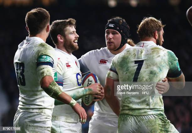 Elliot Daly of England celebrates scoring his sides fourth try with his England team mates during the Old Mutual Wealth Series match between England...