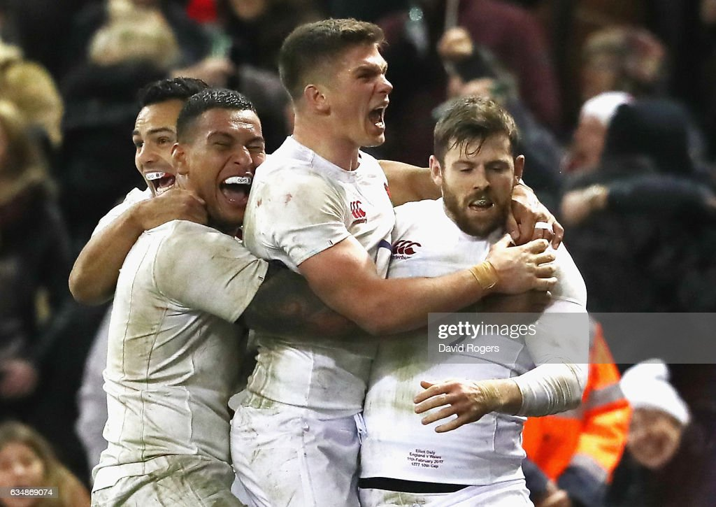 Elliot Daly (R) of England celebrates with team mates after scoring the match winning try during the RBS Six Nations match between Wales and England at the Principality Stadium on February 11, 2017 in Cardiff, Wales.