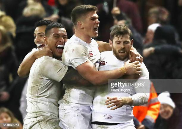 Elliot Daly of England celebrates with team mates after scoring the match winning try during the RBS Six Nations match between Wales and England at...
