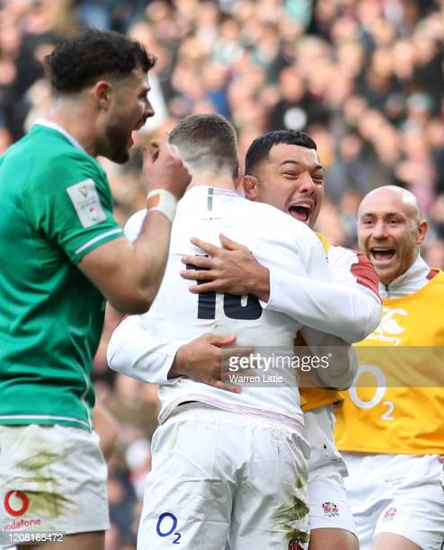 Elliot Daly of England celebrates with teammate Ellis Genge after scoring his sides second try during the 2020 Guinness Six Nations match between...