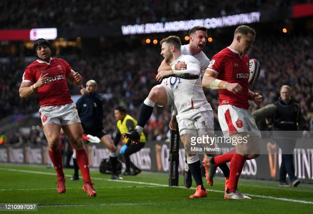 Elliot Daly of England celebrates with teammate George Ford of England after scoring their teams second try during the 2020 Guinness Six Nations...
