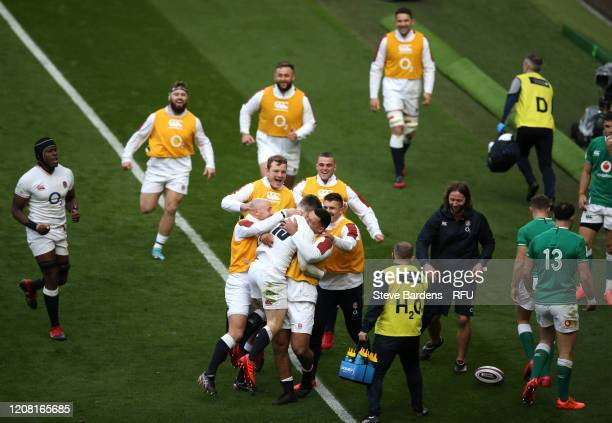 Elliot Daly of England celebrates with teammates after scoring his sides second try during the 2020 Guinness Six Nations match between England and...