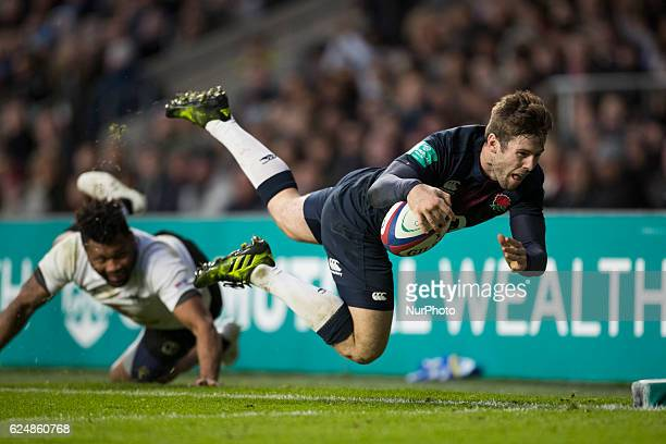Elliot Daly of England dives for the line but is pushed into touch by a diving Metuisela Tabebula of Fiji during Old Mutual Wealth Series between...