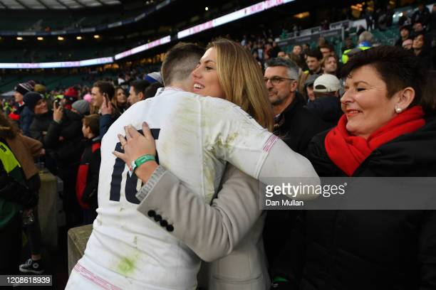Elliot Daly of England embraces his partner Michelle Cussell following the 2020 Guinness Six Nations match between England and Ireland at Twickenham...