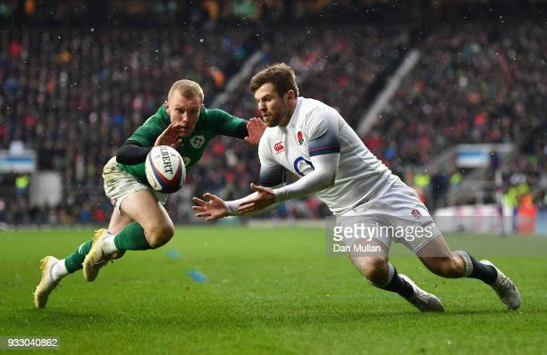 Elliot Daly of England gathers the ball ahead of Keith Earls of Ireland before going on to score his sides first try during the NatWest Six Nations...