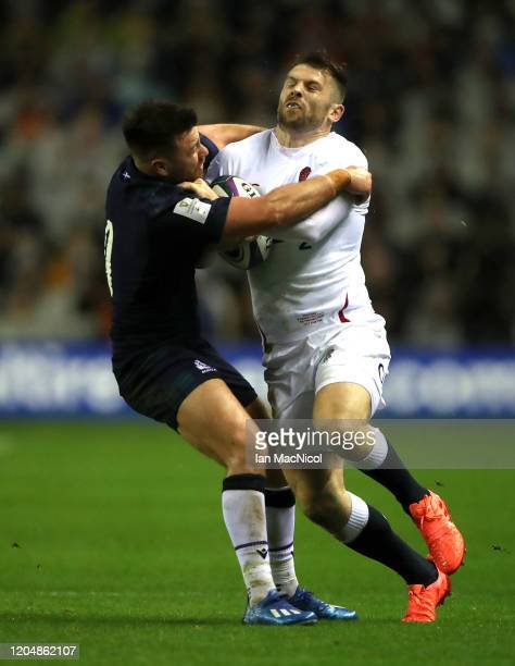 Elliot Daly of England hands off Ali Price of Scotland during the 2020 Guinness Six Nations match between Scotland and England at Murrayfield on...