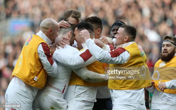 Elliot Daly of England is mobbed by team mates after scoring their second try during the 2020 Guinness Six Nations match between England and Ireland...