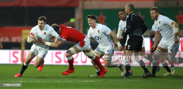 Elliot Daly of England is tackled by Alun Wyn Jones during the Quilter International match between Wales and England as part of the Autumn Nations...