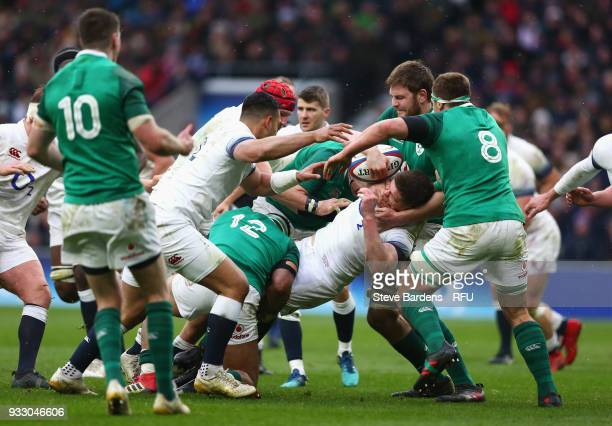 Elliot Daly of England is tackled by Bundee Aki of Ireland during the NatWest Six Nations match between England and Ireland at Twickenham Stadium on...