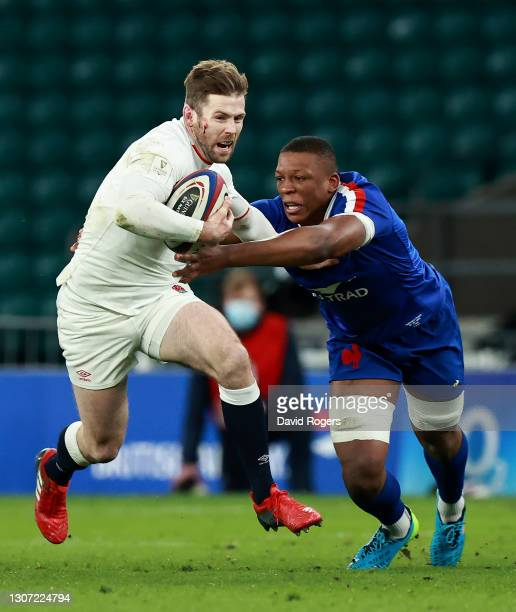 Elliot Daly of England is tackled by Cameron Woki during the Guinness Six Nations match between England and France at Twickenham Stadium on March 13,...