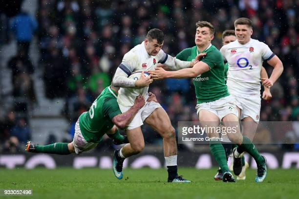 Elliot Daly of England is tackled by Garry Ringrose of Ireland during the NatWest Six Nations match between England and Ireland at Twickenham Stadium...