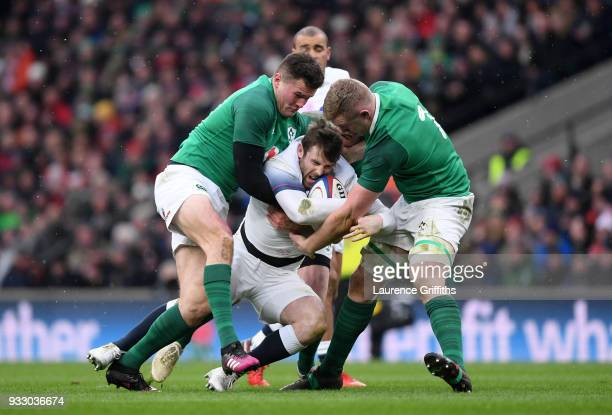 Elliot Daly of England is tackled by Jacob Stockdale of Ireland and Dan Leavy of Ireland during the NatWest Six Nations match between England and...