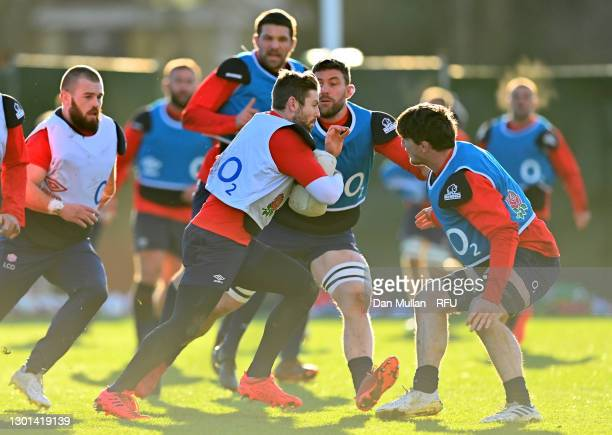 Elliot Daly of England is tackled by Mark Wilson and Tom Curry during the England Training Session ahead of the Guinness Six Nations match between...