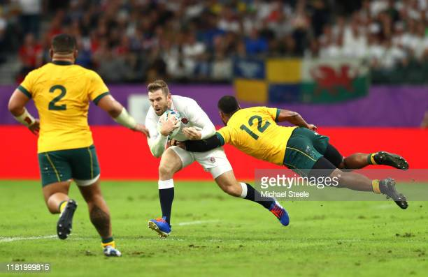 Elliot Daly of England is tackled by Samu Kerevi of Australia during the Rugby World Cup 2019 Quarter Final match between England and Australia at...