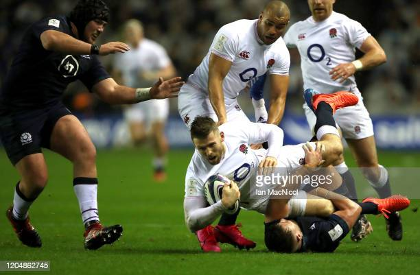 Elliot Daly of England is tackled during the 2020 Guinness Six Nations match between Scotland and England at Murrayfield on February 08 2020 in...