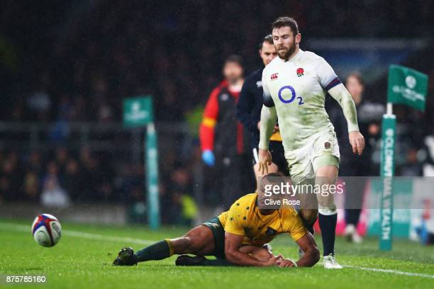 Elliot Daly of England kicks towards the try line leading to his first try during the Old Mutual Wealth Series match between England and Australia at...