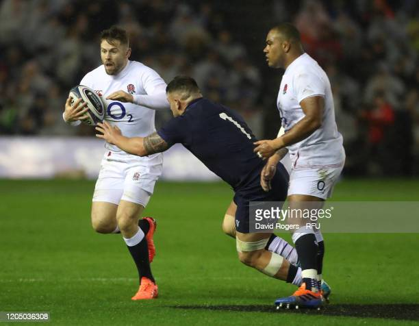 Elliot Daly of England moves past Rory Sutherland during the 2020 Guinness Six Nations match between Scotland and England at Murrayfield on February...