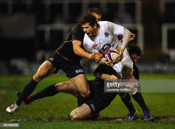 Elliot Daly of England Saxons is tackled by Greig Tonks of Scotland during the International Friendly match between England Saxons and Scotland A at...