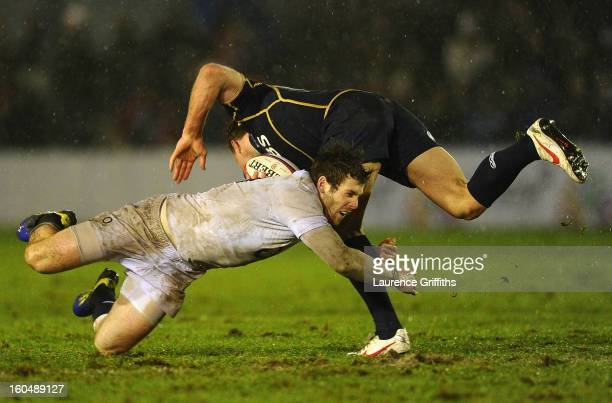 Elliot Daly of England Saxons tackles Greig Tonks of Scotland during the International Friendly match between England Saxons and Scotland A at...
