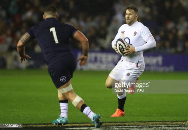 Elliot Daly of England takes on Rory Sutherland during the 2020 Guinness Six Nations match between Scotland and England at Murrayfield on February 08...