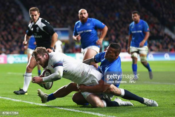 Elliot Daly of England touches down for the fourth try during the Old Mutual Wealth Series match between England and Samoa at Twickenham Stadium on...