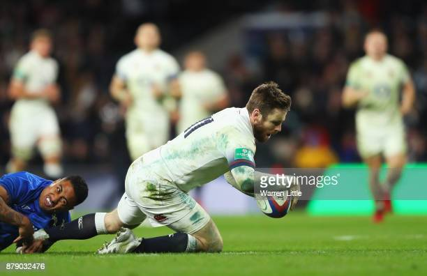 Elliot Daly of England touches down for the sixth try during the Old Mutual Wealth Series match between England and Samoa at Twickenham Stadium on...