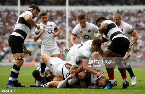 Elliot Daly of England touches down for their first try during the Quilter Cup match between England and Barbarians at Twickenham Stadium on May 27...