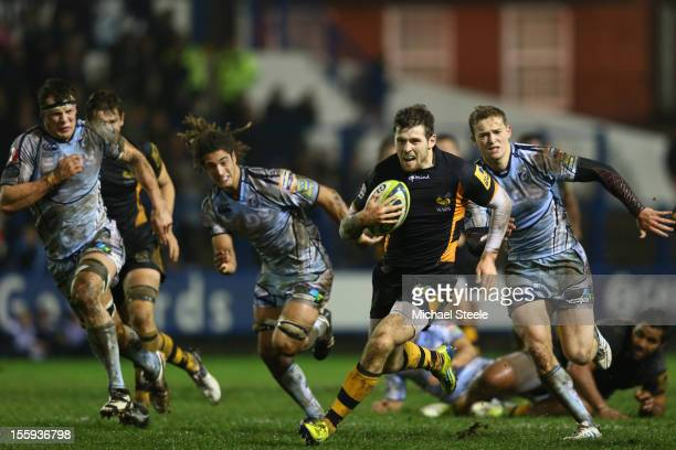 Elliot Daly of London Wasps breaks through the Cardiff Blues defence to score a try during the LV Cup Pool match between Cardiff Blues and London...