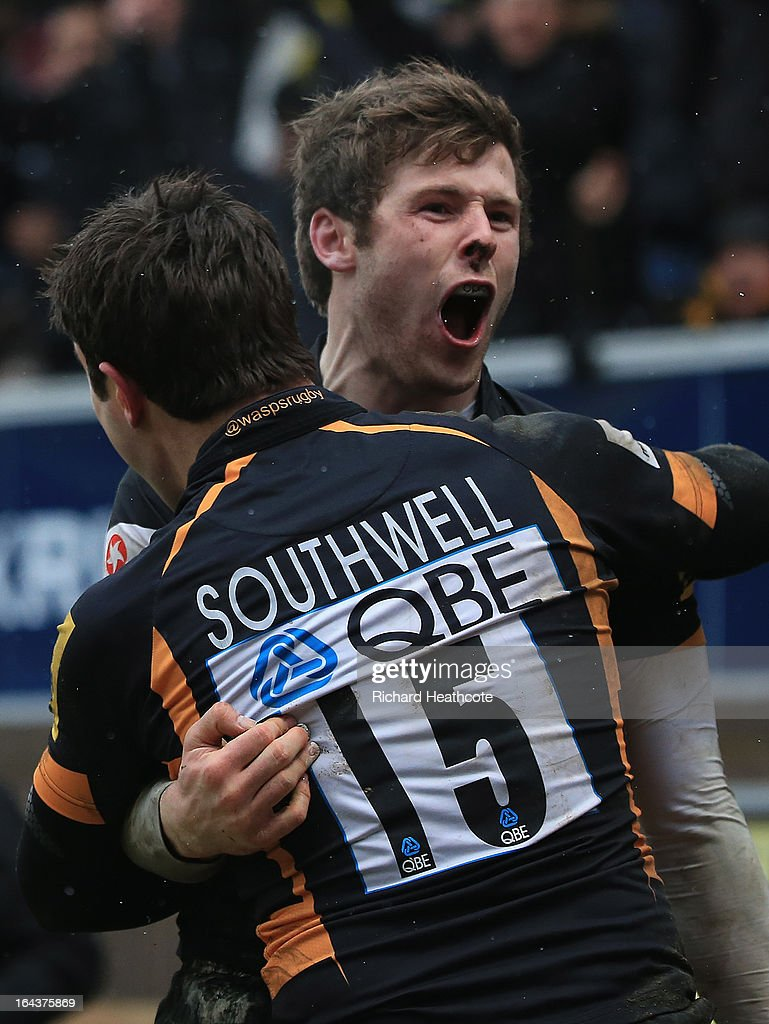 Elliot Daly of London Wasps celebrates scoring his team's second try with team-mate Hugo Southwell during the Aviva Premiership match between London Wasps and Northampton Saints at Adams Park on March 23, 2013 in High Wycombe, England.