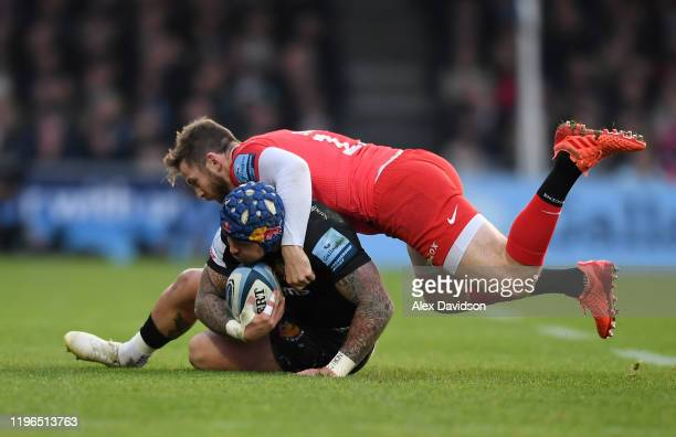 Elliot Daly of Saracens is tackles Jack Nowell of Exeter Chiefs during the Gallagher Premiership Rugby match between Exeter Chiefs and Saracens at...