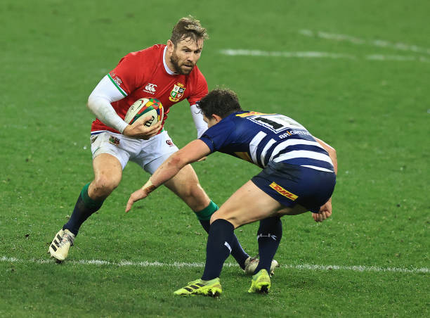 CAPE TOWN, SOUTH AFRICA - JULY 17: Elliot Daly of the British & Irish Lions is tackled during the match between the DHL Stormers and the British & Irish Lions at Cape Town Stadium on July 17, 2021 in Cape Town, South Africa. (Photo by David Rogers/Getty Images)
