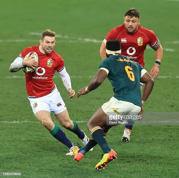 Elliot Daly of the British & Irish Lions takes on Siya Kolisi during the 1st Test match between the South Africa Springboks and the British & Irish...
