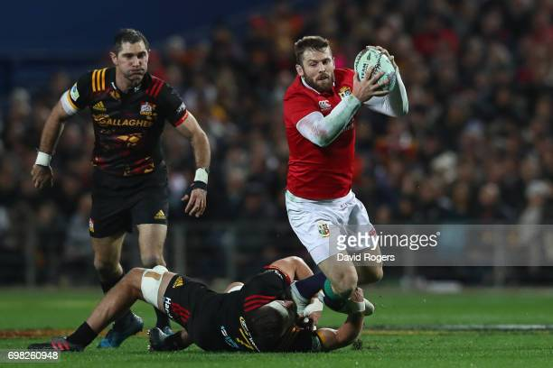 Elliot Daly of the Lions is tackled by Lachlan Boshier of the Chiefs during the 2017 British Irish Lions tour match between the Chiefs and the...