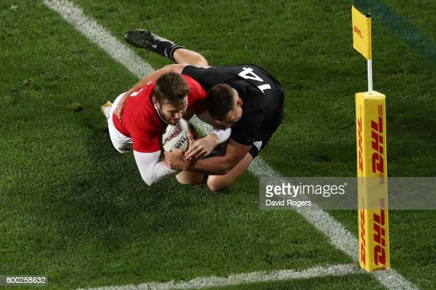 Elliot Daly of the Lions is tackled short of the tryline by Israel Dagg of the All Blacks during the first test match between the New Zealand All...