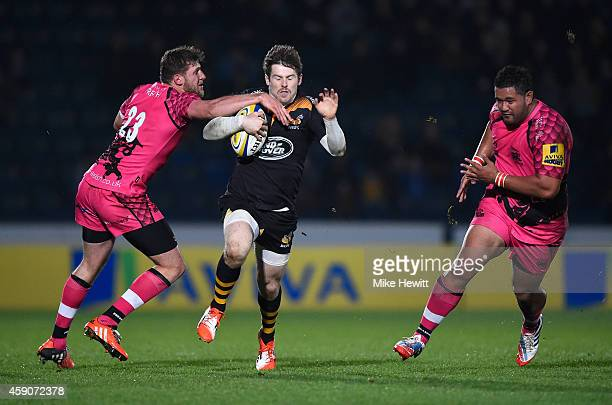 Elliot Daly of Wasps breaks through a tackle from Alan Awcock of London Welsh during the Aviva Premiership match between Wasps and London Welsh at...
