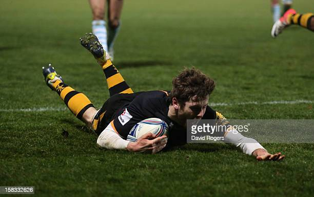 Elliot Daly of Wasps dives to score the first try during the Amlin Challenge Cup match between London Wasps and Bayonne at Adams Park on December 13...