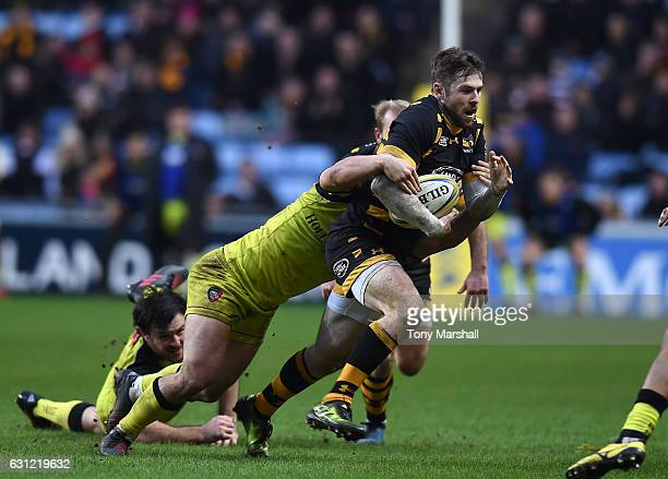 Elliot Daly of Wasps is tackled by Will Evans of Leicester Tigers during the Aviva Premiership match between Wasps and Leicester Tigers at The Ricoh...