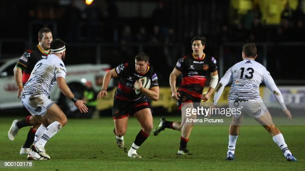 Elliot Dee of Dragons is marked by Scott Baldwin of Ospreys during the Guinness Pro 14 match between Newport Gwent Dragons and Ospreys at the Rodney...