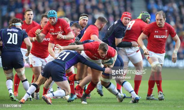 Elliot Dee of Wales is tackled by Greig Laidlaw of Scotland during the Guiness 6 Nations match between Scotland and Wales at Murrayfield on March 09...