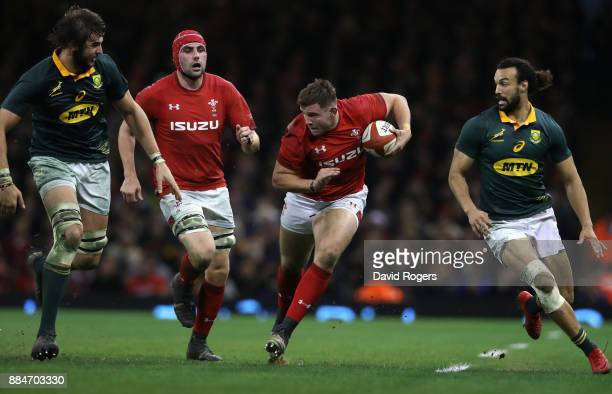 Elliot Dee of Wales takes on Lood de Jager and Dillyn Leyds during the rugby union international match between Wales and South Africa at the...