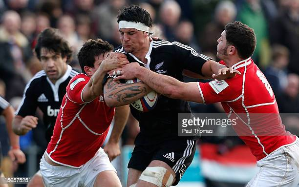 Elliot Dixon of New Zealand Maori All Blacks in action with Charlie Hayter and Jacob Rowan of the RFU Championship XV during the RFU Championship XV...