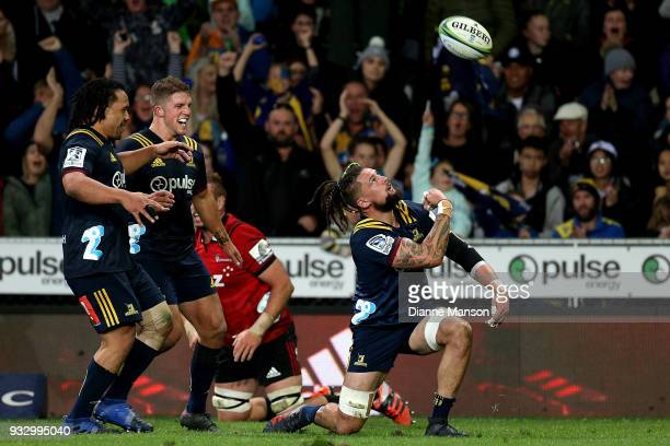 Elliot Dixon of the Highlanders celebrates his try during the round five Super Rugby match between the Highlanders and the Crusaders at Forsyth Barr...