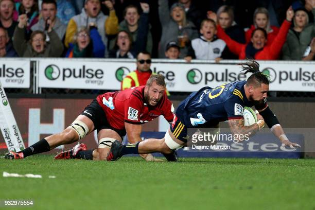 Elliot Dixon of the Highlanders dives over to score a try during the round five Super Rugby match between the Highlanders and the Crusaders at...