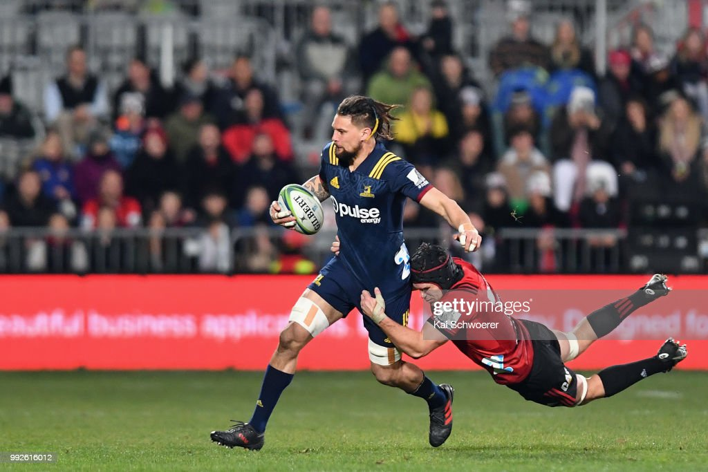 Elliot Dixon of the Highlanders is tackled by Matt Todd of the Crusaders during the round 18 Super Rugby match between the Crusaders and the Highlanders at AMI Stadium on July 6, 2018 in Christchurch, New Zealand.