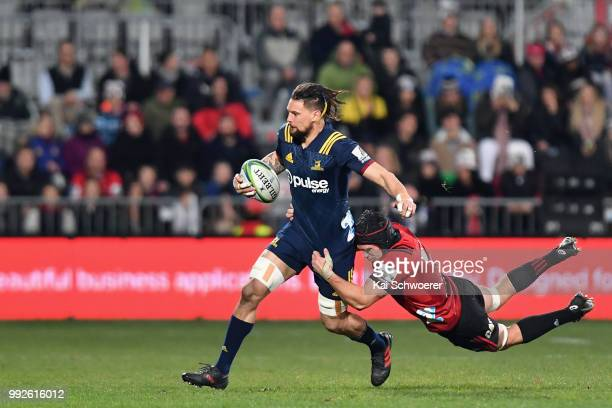 Elliot Dixon of the Highlanders is tackled by Matt Todd of the Crusaders during the round 18 Super Rugby match between the Crusaders and the...