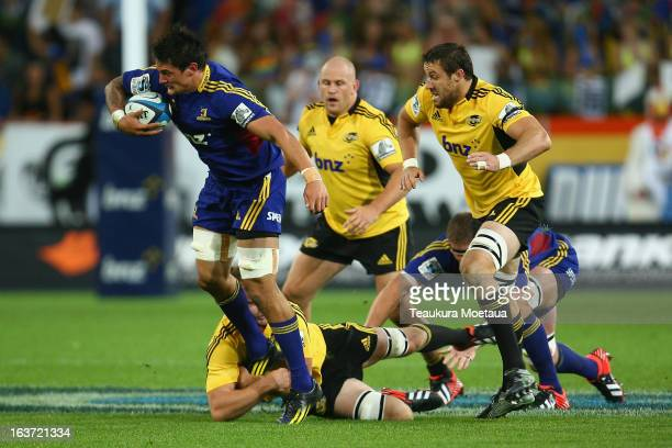 Elliot Dixon of the Highlanders is tackled during the round five Super Rugby match between the Highlanders and the Hurricanes at Forsyth Barr Stadium...